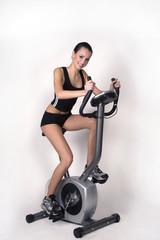 Girl and a stationary bike