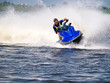canvas print picture - Man on Wave Runner on the water