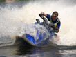 canvas print picture - Man on jet-ski turns very fast with diving