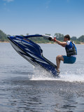 Jumping man on jet ski