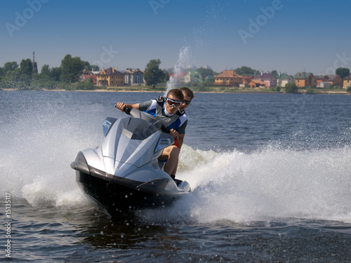 Couple men on jet ski