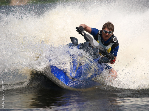 Canvas Water Motorsp. Man on jet-ski turns very fast with diving