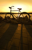 Bicycle at sundown with shadow poster