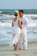 Bride and groom kissing at the oceanfront