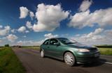 Road, car, blue cloudy sky