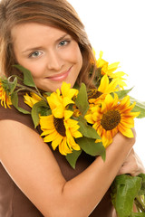 Portrait of young woman with sunflowers