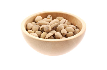 pistachios in a wood bowl