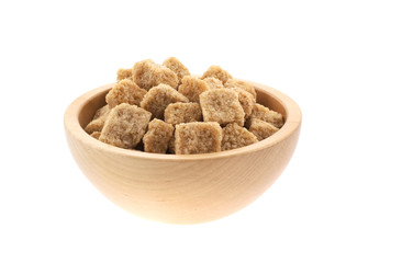 brown sugar cubes in a wood bowl