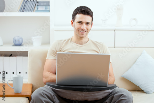 Man browsing internet at home