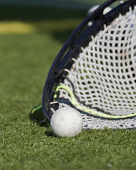 Lacrosse goalie stick scooping up ball