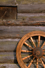 Spinning Wheel On The Log Hut Wall