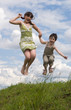 Two jumping children - brother and sister