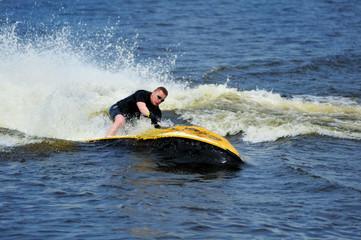 Young man riding jet ski