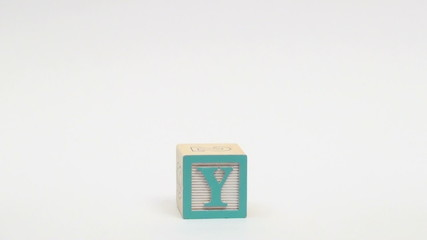Wooden building blocks spell out BUY