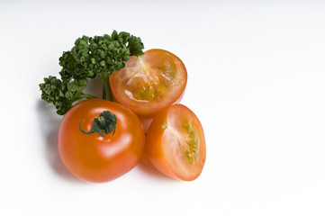 Cherry tomato and parsley on white background