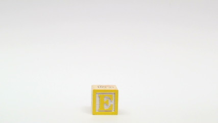 Wooden alphabet blocks spell out SAVE