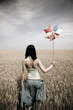 girl with toy wind turbine in retro style