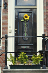 entrans in Amsterdam with sunflower