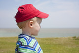 boy gazing out to sea poster