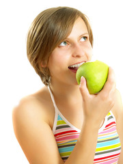 Cute girl eating a fresh green apple