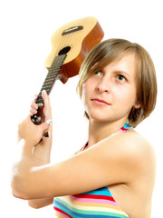 Attractive girl fighting with a guitar