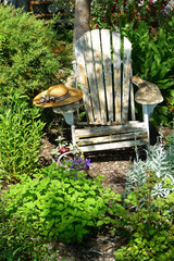 Weathered Chair And Hat In Picturesque Garden Scene