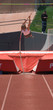 Girl pole vaulting