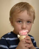 Blond Boy eating ice cream
