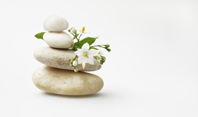wellness still life: pebbles and white jasmine