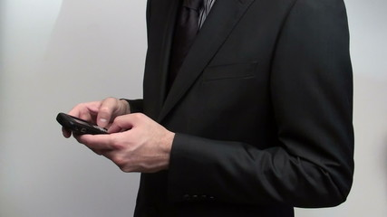 Texting businessman - HD