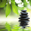 roleta: Zen stones pyramid on water surface, green leaves over it