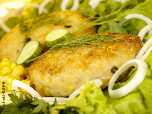 Pork rissole in tempura with greenery and vegetables