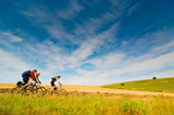 Fototapety cyclists relax biking outdoors