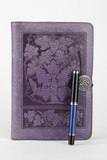 Leather bound purple journal and pen poster