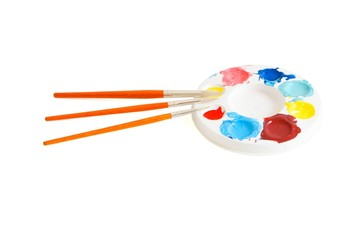 Round kids' palette with three paintbrushes isolated