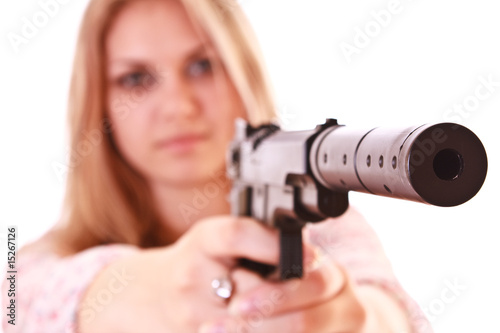 Young woman with pistol on white background