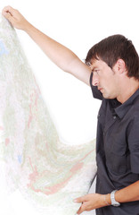 Man standing and looking at maps in his hands