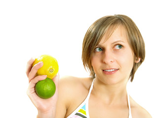Cute girl holding lemon and lime