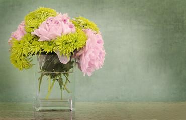 peonies and chrysanthemums in vase