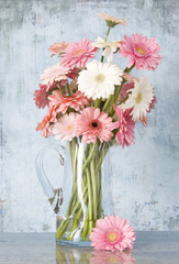 jug of daisies - blue background