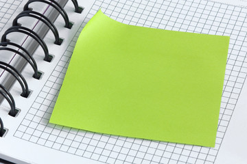 Notebook and green sticker