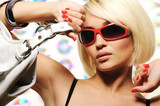 Fototapety trendy woman with  red sunglasses holding white handbag