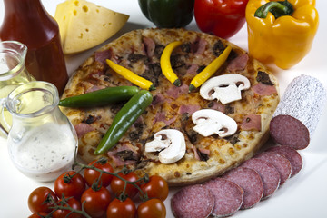 Vegetables with a pizza
