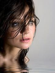 Beautiful wet brunette in water