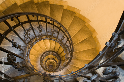 Spiral staircase, handrail and stone steps in ancient tower - 15311353