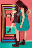 teen girl look herself in mirror poster