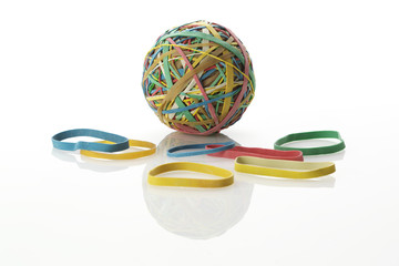 Isolated colourful rubber band ball with bands