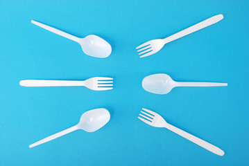 White disposable dishes, fork and spoon