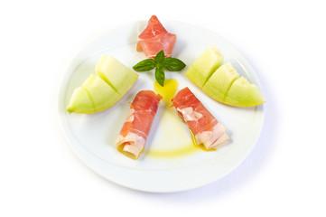 Raw ham and yellow melon