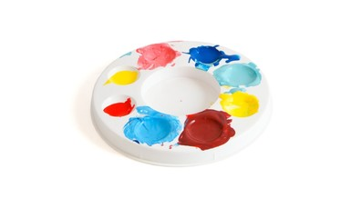 Round kids' palette with colorful paints isolated